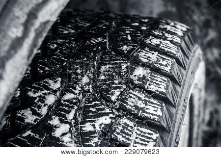 Snow Tire With Metal Studs, Which Improve Traction On Icy Surfaces, Close-up Photo Of Car Wheel With