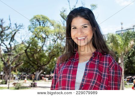 Cute Caucasian Woman With Hipster Shirt Outdoors In Summer In City