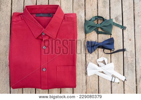 Flat Lay Set Of Male Shirt And Various Color Bowtie On Wooden Background