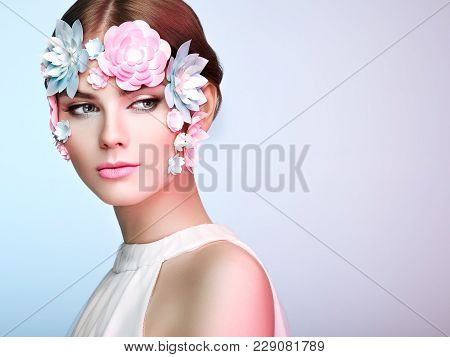 Face Of Beautiful Woman Decorated With Flowers. Perfect Makeup. Beauty Fashion Model Woman Face Perf