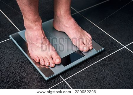 Male Feet On The Scale