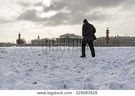 Man Walks Across A Frozen River, View Of Vasilievsky Island From The River, The Exchange Building, I