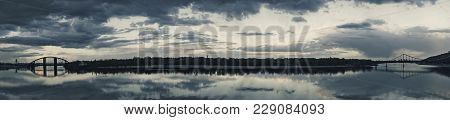 Panoramic View, Two Bridges Construction With Reflection In River Dnieper, Kiev, Ukraine. Dnipro, Ky