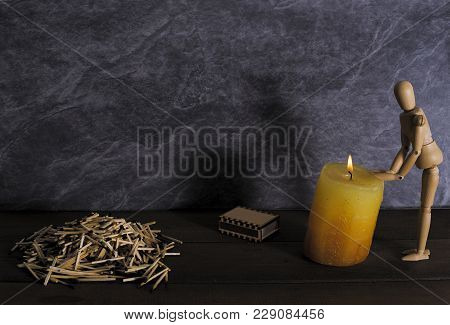 Wooden Dummy For Drawing Warm Hands From Fire From A Candle