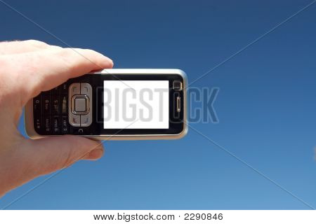 A mobile phone on a blue sky background. Copy-space on the screen. poster