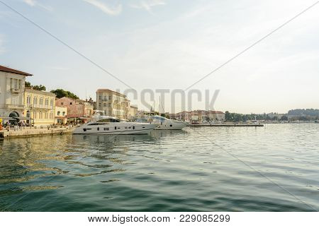 Porec, Croatia, September 24, 2017: Tourist Walking On The Porec Marina Dock And Looking At The Luxu