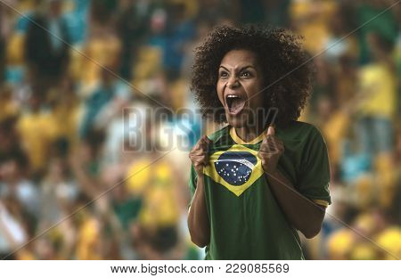Afro young Brazilian woman fan celebrating
