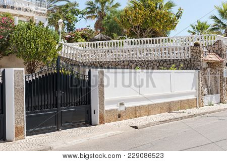 New Dark Metal Double Gates For Entry Of Cars Into The Yard Closed