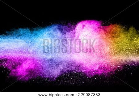 Multicolored Powder Explosion Cloud Isolated On Black Background. Freeze Motion Of Color Dust  Parti