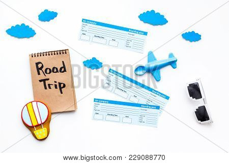 Family Trip Concept. Airplan Toy, Air Balloon Cookie, Airplan Tickets. Road Trip Hand Lettering In N