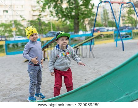Two Little Boys Friends In Sunny Day. Brother Love. Concept Friendship. Portrait Of Two Boys, Brothe