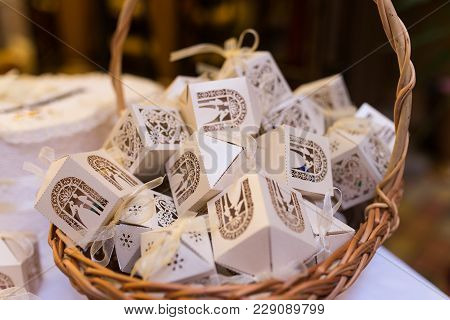 White Boxes For Guest Attending The Wedding In The Basket. Shaped Favors The House That Contain Conf