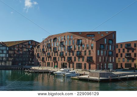 Copenhagen, Denmark - April 30, 2017: Waterfront Of Christianshavn District With Boats And Modern Re