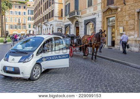 Rome, Italy - June 17, 2014: Police Car, Horse Cart With A Coach For Tourists On The Streets Of Rome