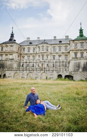 Lovely Couple In Love Against Old Castle. Girl In Blue Dress.