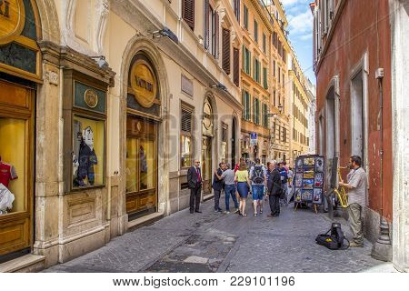 Rome, Italy - June 17, 2014: People Walking Along Narrow Cobblestone Streets With Shops,trade With S