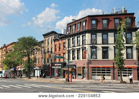 New York, Usa - July 6, 2013: People Walk In Prospect Heights, Brooklyn. New York City Is Visited By