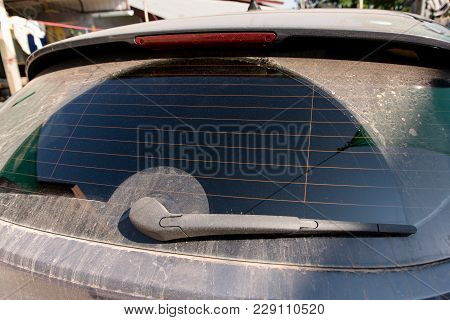 Close Up Dirty Of The Car With Back Glass With Wiper. Dirty Of Windshield