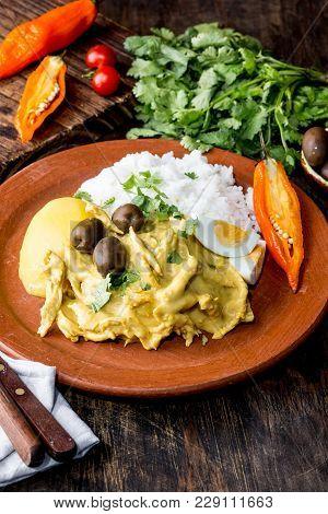 Mexican And Peruvian Cuisine. Aji De Gallina. Chicken Aji De Gallina With Olives Egg And Rice On Cla