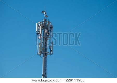 Antenna Tower On Blue Sky As Background