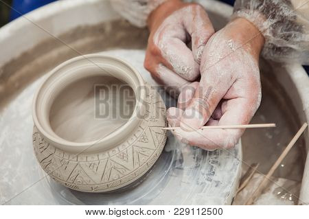 Man Hands Make Potter Inflicts A Decorative Pattern On Pot