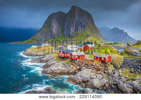 Norway, Lofoten Islands. Spring Day In Norway. Beautiful Seascape Of Lofoten Islands. Red Fishing Ho