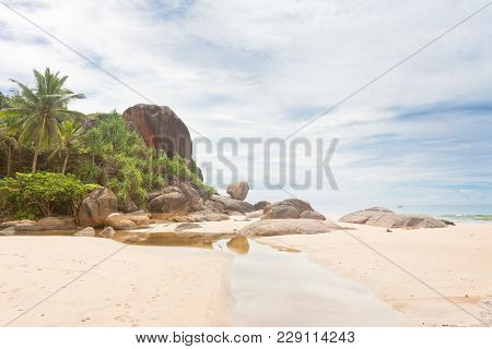Bentota, Sri Lanka, Asia - A Small River In Front Of Huge Granite Rocks And Palm Trees