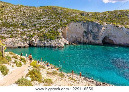 Zakynthos, Greece - October 1, 2017: People Sunbathing On Porto Limnionas Beach. Zakynthos Island, G