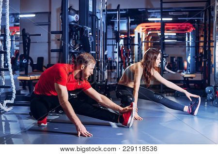 Sports Girls In The Gym Teamwork Perform Exercises For The Muscles Of The Press