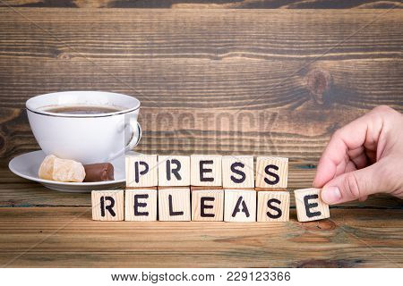 Press Release. Wooden Letters On The Office Desk, Informative And Communication Background.