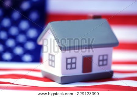 House with American flag. American Real Estate concept. United States Housing Market Concepts.