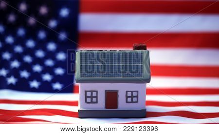 Solar Power Roof concept. Solar Panels on a house with an American flag. Solar Independence in the USA concept.