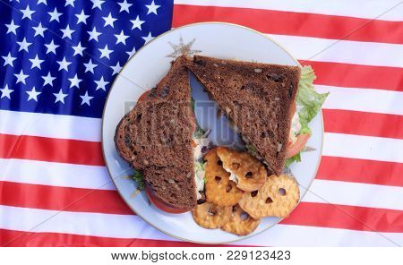 Chicken Salad Sandwich on am American flag. American Lunch. Food and drink concept.