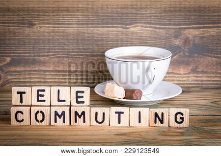 Telecommuting. Wooden Letters On The Office Desk, Informative And Communication Background.