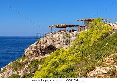 Tavern On Cliff With View Of Bay And Korakonisi Island On Western Side Of Zakynthos. Zante, Greece
