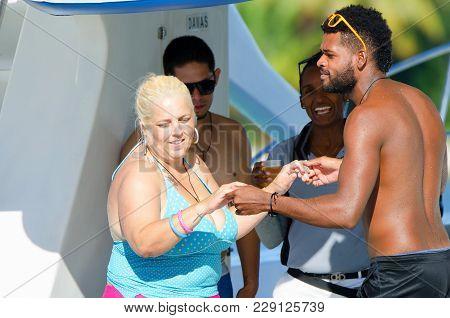 Santo Domingo, Dominican Republic - October 29, 2015: Local Dominican Man Teaching Female Tourist Me