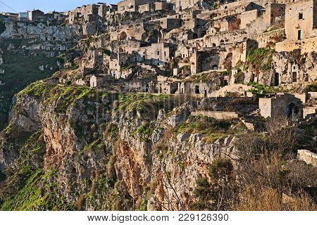 Matera, Basilicata, Italy: Landscape At Sunrise Of The Old Town Called Sassi Di Matera With The Hous