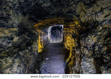 Abandoned And Collapsed Sandstone Or  Limestone Mine Illuminated By Color Lights, Sevastopol, Crimea