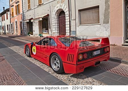 Gatteo, Fc, Italy - May 19, 2017: Crew On A Sports Car Ferrari F40 (1980) In Rally Ferrari Tribute T