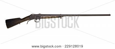 Old Hunting Shotgun With A Darkened Cracked Butt, Remade From An Army Rifle, Isolated