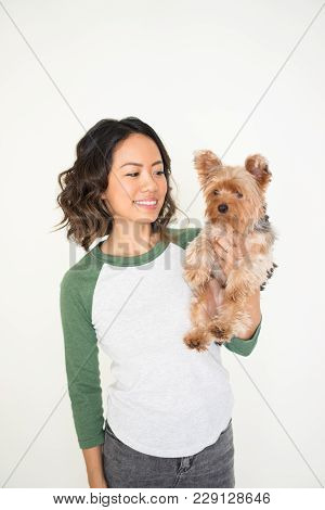 Closeup Portrait Of Smiling Young Attractive Woman Holding Yorkshire Terrier. Yorkshire Terrier Conc