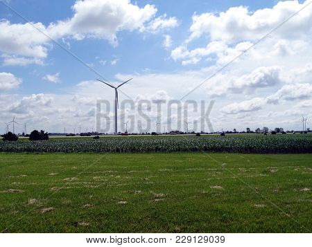 A Panoramic View Of Several Wind Generators Located In Agricultural Land In Indiana