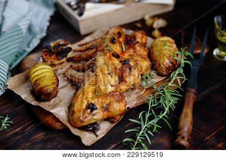 Chicken Wings Grill With Potatoes And Rosemary