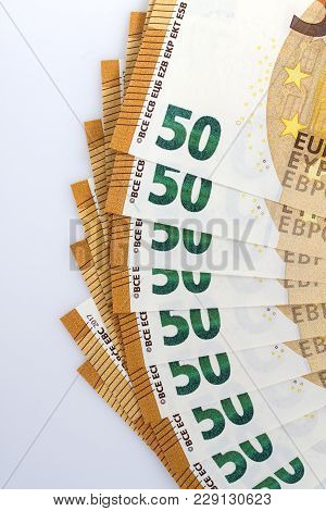 Lot Of Fifty Euros Banknotes On White Background
