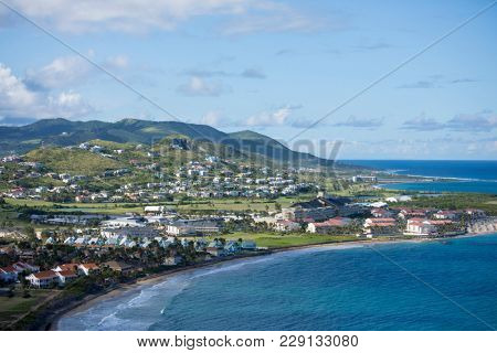Low aerial view of resorts and beaches in St Kitts.
