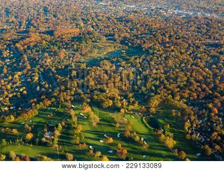 Aerial view of autumn colors and golf course neighborhood in New Jersey, USA.