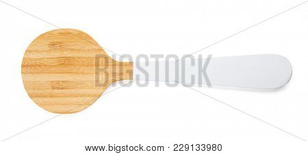 Wooden spatula on white background. Handcrafted cooking utensils