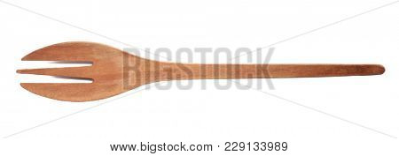 Wooden fork on white background. Handcrafted cooking utensils