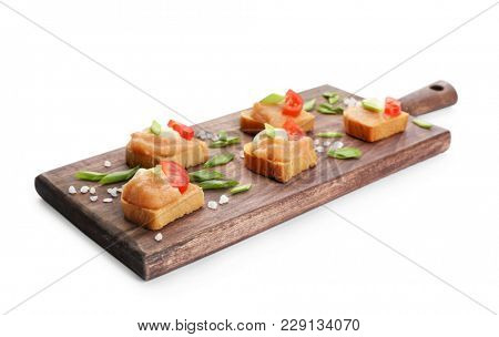 Wooden board with delicious cod caviar appetizers on white background