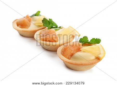 Delicious appetizers with cod caviar on white background